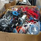 large box of sorted electronic waste